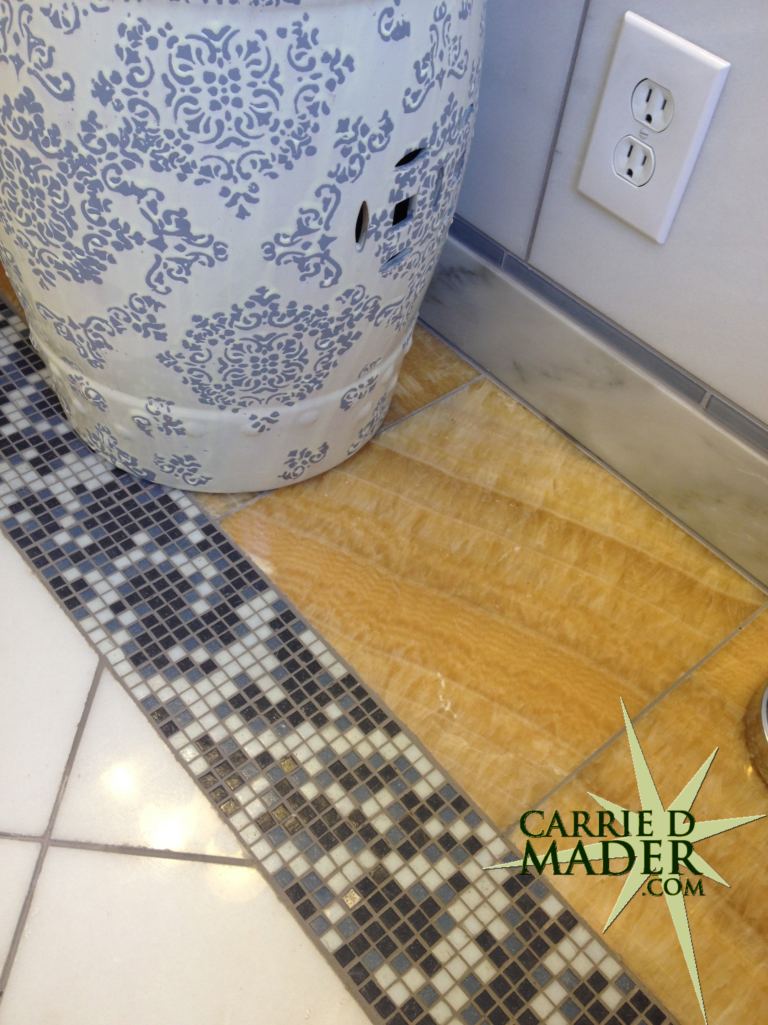 The story about the bathroom floor carrie d mader for Glass tile border bathroom ideas